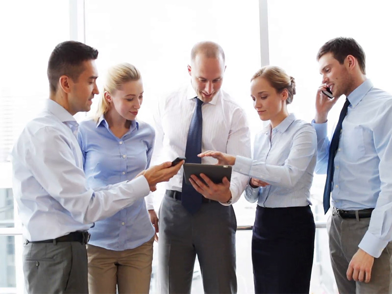 business-teamwork-people-and-technology-concept-business-team-with-tablet-pc-and-smartphones-meeting-in-office-masof.jpg